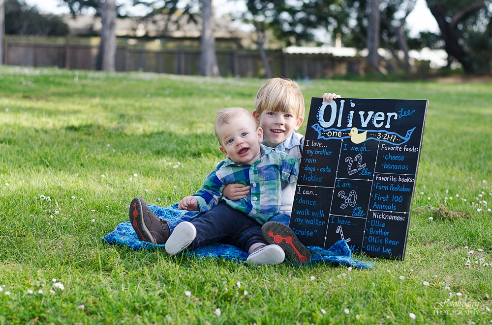 Brothers holding up 1st birthday sign - Monterey Bay Family Portraits