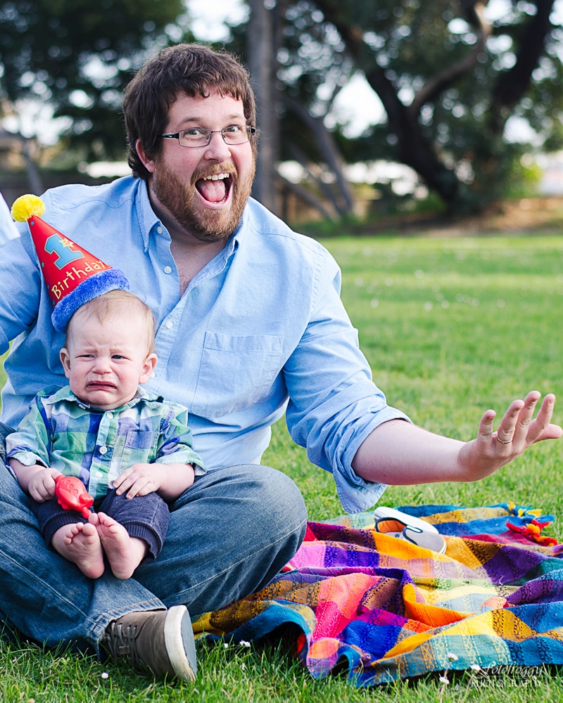Adorably crying boy with birthday hat and smiling Dad. Monterey Bay Family Photography