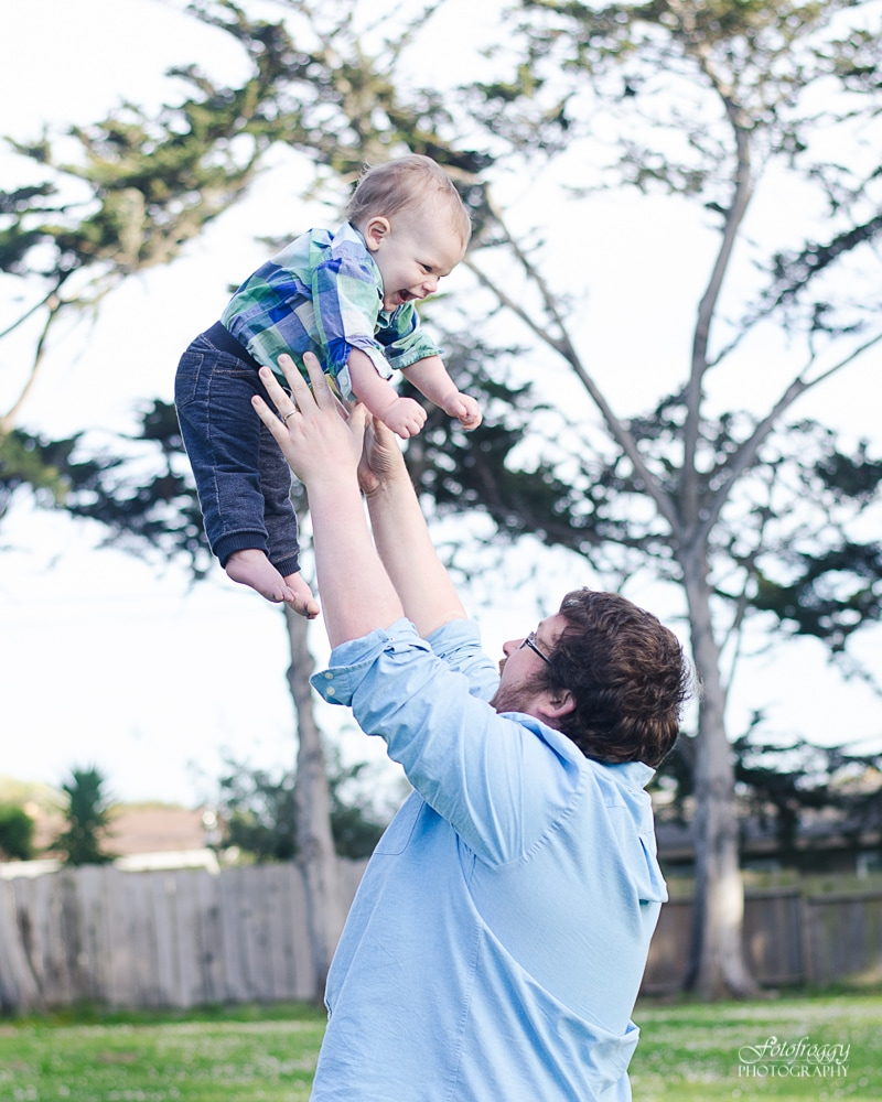 Dad tossing baby boy in the air, Monterey Bay Family Portraiture