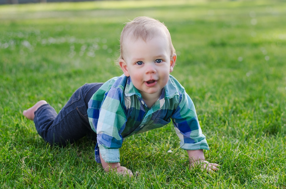 Sweet boy crawling at the park. Marina Family Photography