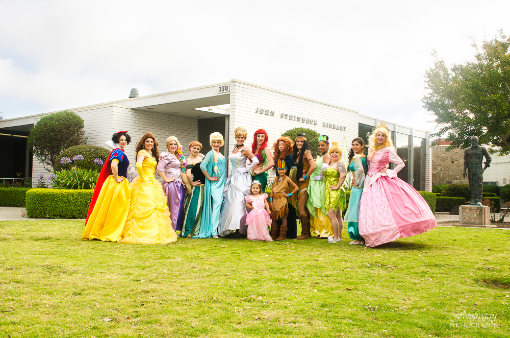 13 colorful princesses in front of Steinbeck Library Salinas Ca, All That Glitters Princess Parties