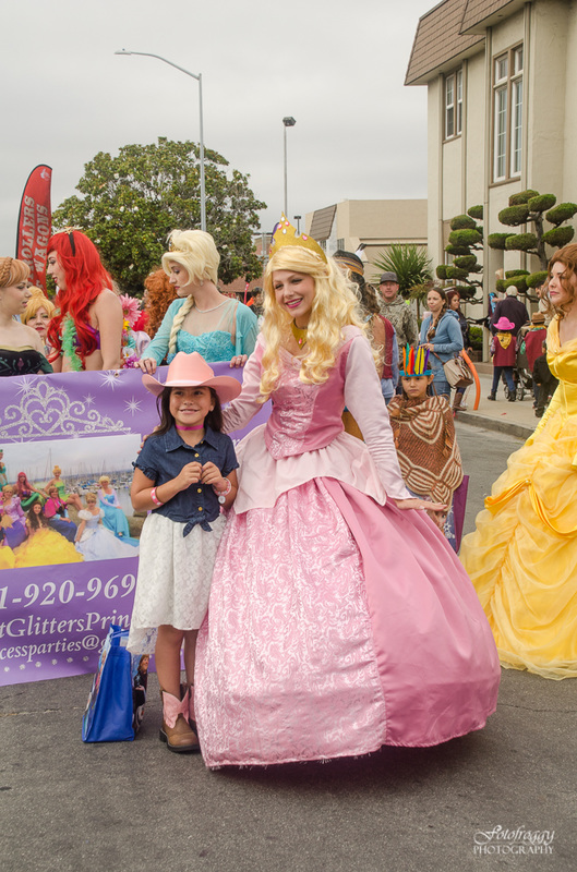 Princess in pink ballgown with adorable little cowgirl at Kiddie Kapers Parade Salinas Ca