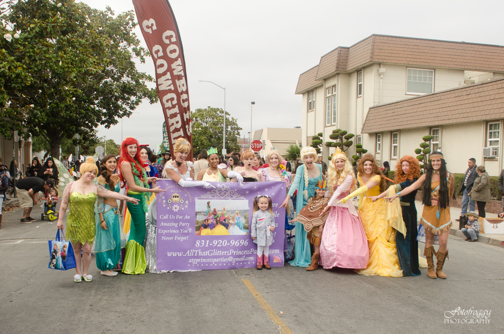 Adorable little girl surrounded by princesses at Kiddie Kapers Parade Salinas Ca