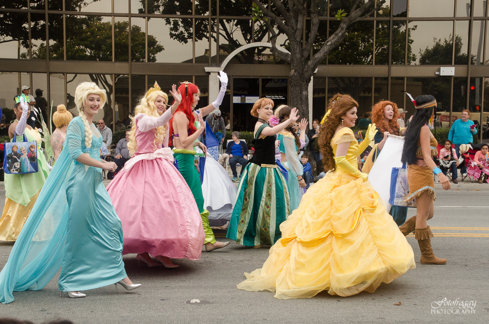 Beautiful princesses walking down Main Street in Salinas parade