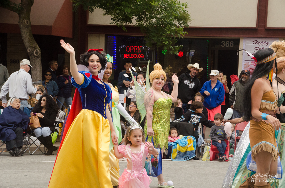 Colorful characters wave to the crowd in Salinas parade - Kiddie Kapers