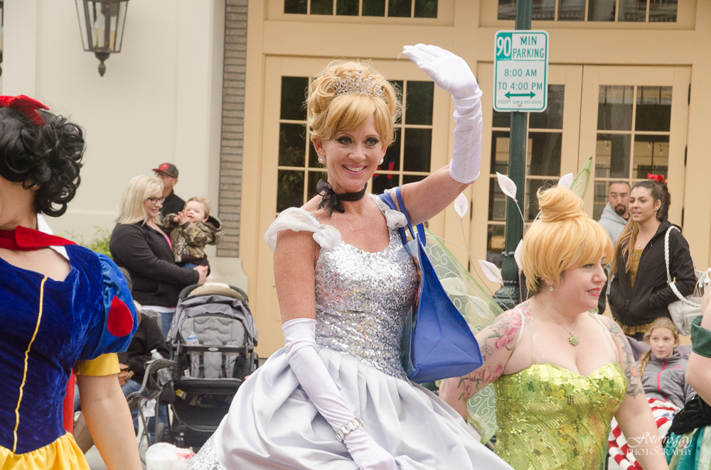 Glittery silver princess waves at Kiddie Kapers Parade Salinas Ca
