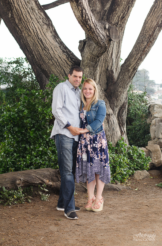 Cute couple's portrait in front of large trees Pacific Grove family photography