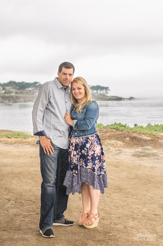 Couple in blue, gray sky oceanview Pacific Grove Lover's Point family photography
