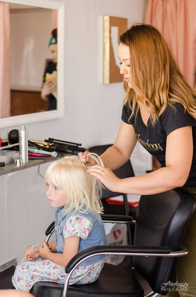 Little girl getting her hair braided at Glamology Beauty Lounge - www.fotofroggy.com