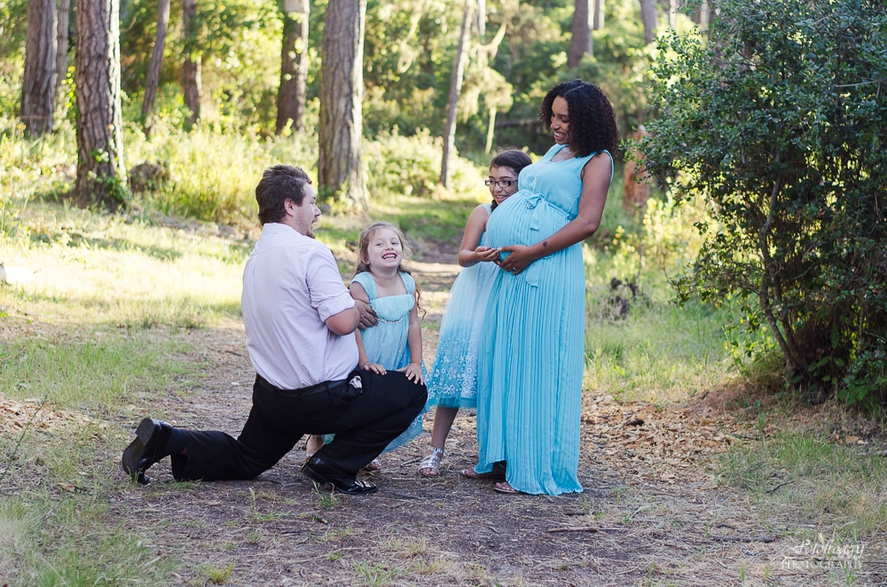 Sweet family laughing during Maternity session.