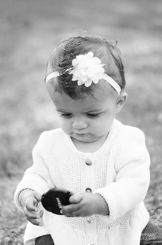 Fotofroggy Photography - black and white little girl with Nikon lenscap