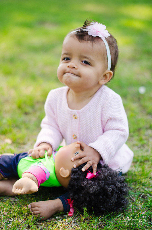 Fotofroggy Photography - baby girl puckering up to kiss her doll